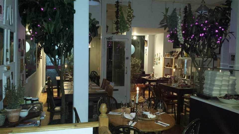 Photo of MissWallsBackGarden Cafe at night
